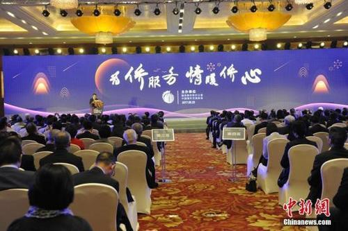 """中国国务院侨务办公室、中国海外交流协会在北京举办""""为侨服务日""""活动。中新网记者 富宇 摄"""