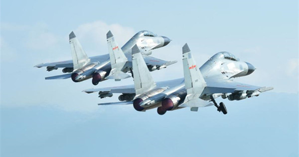 Multi-type fighter jets conduct live-fire training in S China Sea