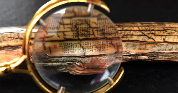 Magnifying glass needed to read tiny carved characters