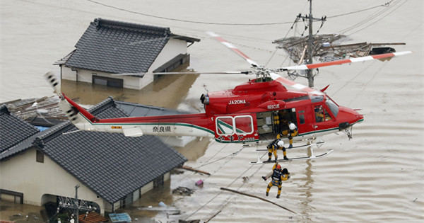Torrential rains kill at least 88 in western Japan