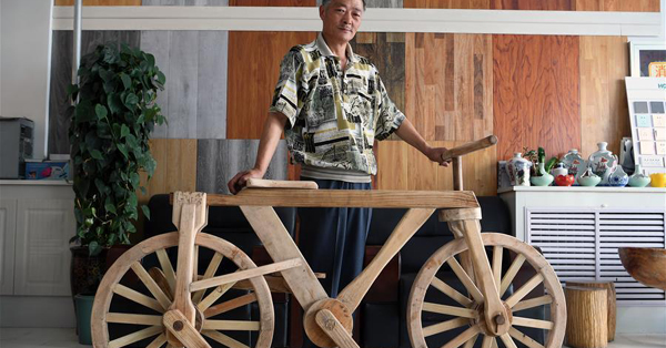 55-year-old farmer and his wooden bicycle in Gansu