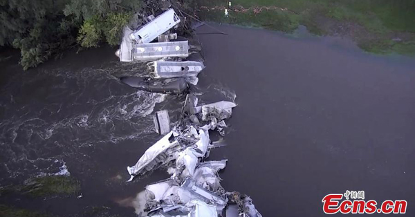 Train derails in Iowa, dumping cars into river