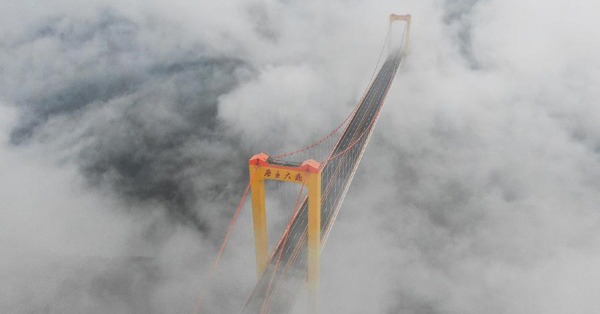 Enormous Puli Bridge swallowed by clouds