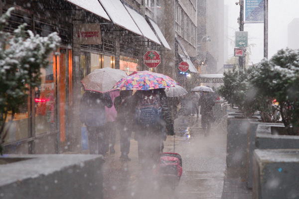 6d3942c9ec0 People walk through the first snow of the season in New York City