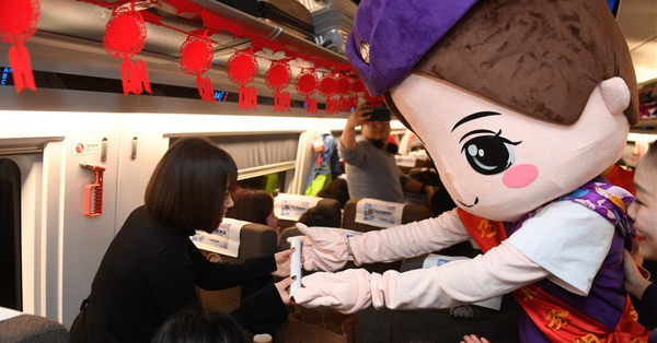 Bullet train staff extend Spring Festival greetings to passengers