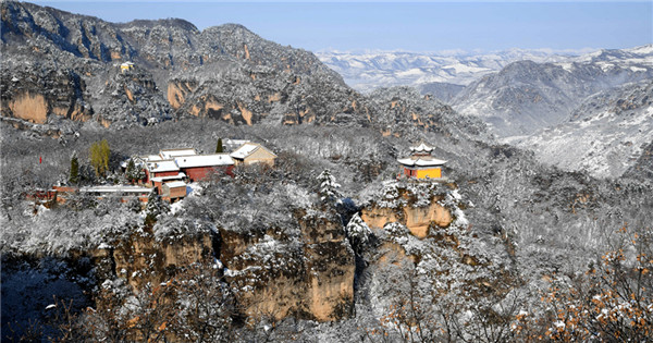 Snow-covered Taoism mountain reveals special charm