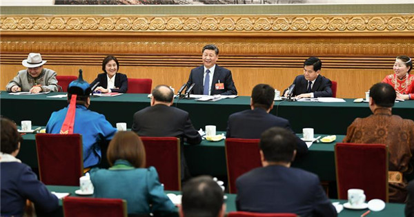 Xi attends panel discussion