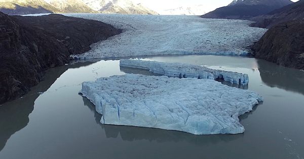 Two new icebergs break off from the Grey glacier in Chile