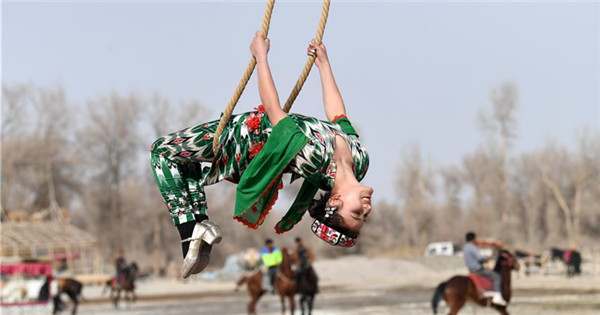 Uygur people participate in Shaghydi game in Xinjiang
