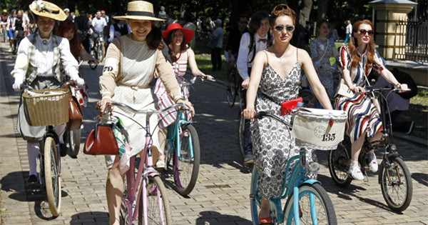 People in vintage clothes attend cycling event in Ukraine