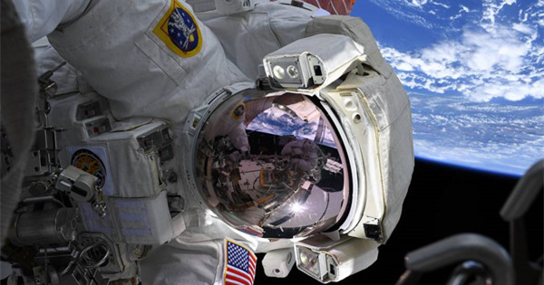 NASA astronauts spacewalk outside the International Space Station