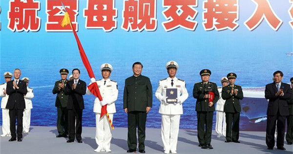 Xi attends commissioning of first Chinese-built aircraft carrier