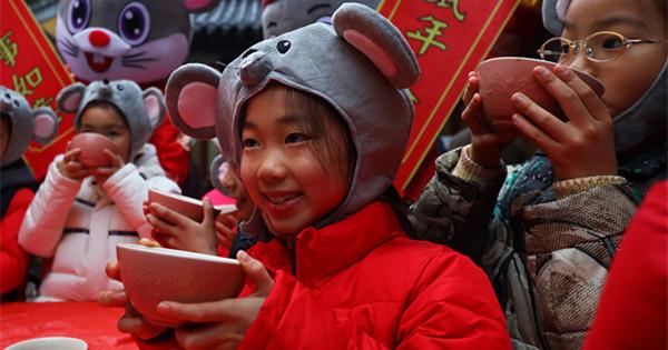 People mark festival with 'eight treasure porridge'