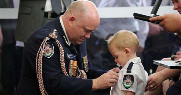 Toddler son receives posthumous medal for killed Australian firefighter