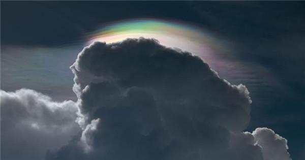 Cloud iridescence, rainbow irisation seen in Thailand