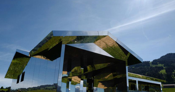Artist's mirrored 'mirage' house installed in Swiss alps
