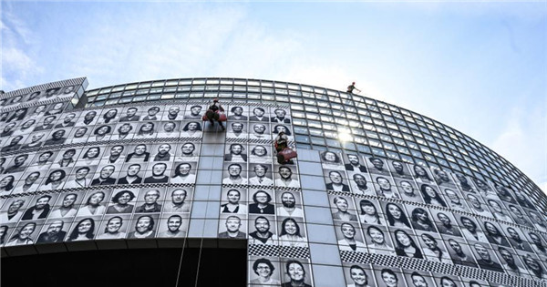 Portraits of health workers installed to pay tribute to medical staff in Paris