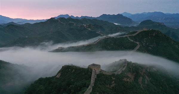 Jinshanling Great Wall shrouded in morning mist