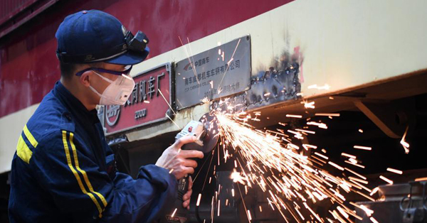 Technicians maintain trains at workshop for Spring Festival travel rush