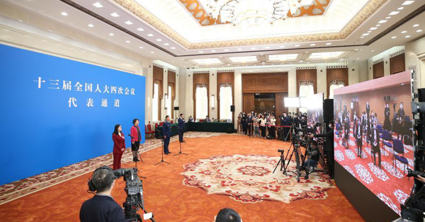 NPC deputies receive interview before annual session