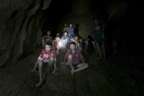 Photo provided by Thai Navy Seal shows trapped teenagers in a cave in Mae Sai, Chiang Rai province, northern Thailand, on July 2, 2018. Twelve teenagers and their football coach, trapped in a cave in northern Thailand for nine days, have been found alive on Monday night, Narongsak Osottanakorn, governor of Chiang Rai province said. (Xinhua)