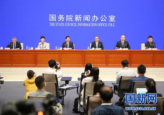 NHC officials speak at a news conference at the State Council Information Office in Beijing on May 15, 2020. /SCIO