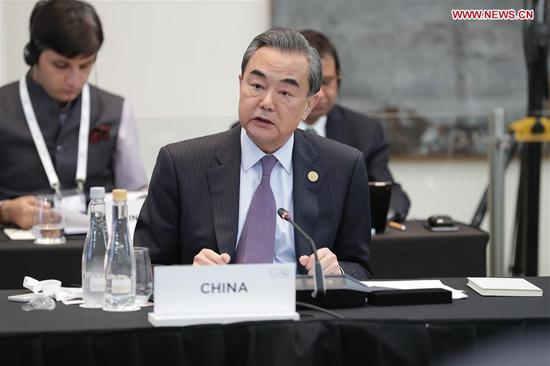 Chinese FM urges adherence to multilateralism, improvement of global governance