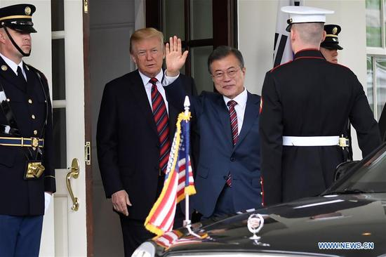 U.S. President Donald Trump (2nd L) welcomes visiting President of the Republic of Korea (ROK) Moon Jae-in (3rd L) at the White House in Washington D.C., the United States, on May 22, 2018. (Xinhua/Yang Chenglin)