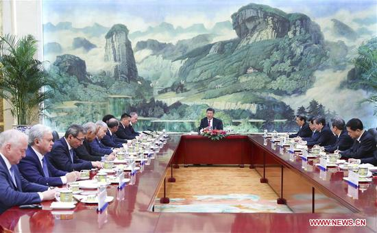 Chinese President Xi Jinping meets with heads of foreign delegations attending the 13th meeting of Security Council Secretaries of the Shanghai Cooperation Organization (SCO) in Beijing, capital of China, May 22, 2018. (Xinhua/Xie Huanchi)