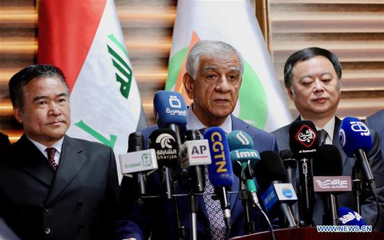 Iraq signs deal with Chinese company to develop oil field in Baghdad province