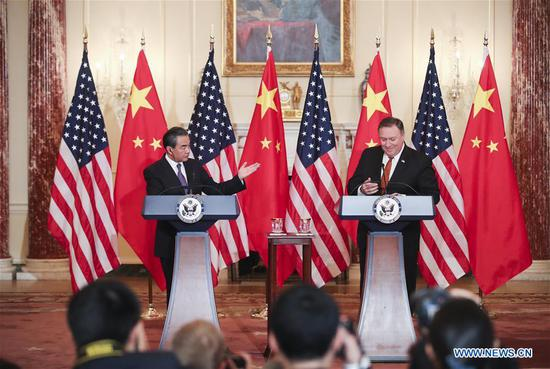 Chinese FM meets with U.S. counterpart, highlights bids to promote bilateral ties