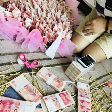 Cash bouquet suspected of breaking law