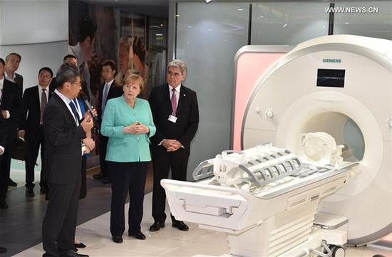 German Chancellor Angela Merkel visits enterprises in Shenzhen