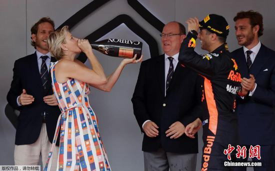 Monaco Grand Prix: Princess Charlene drinks champagne