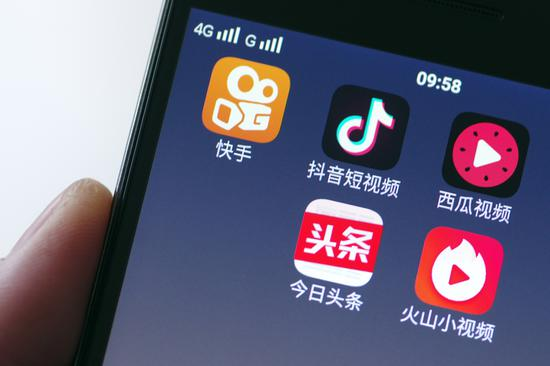Mobile video apps including Kuaishou, Douyin, Xigua and Huoshan are displayed on the screen of a 4G smartphone. (Photo provided to China Daily)