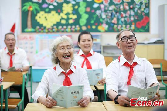 Elderly people in Children's Day costumes