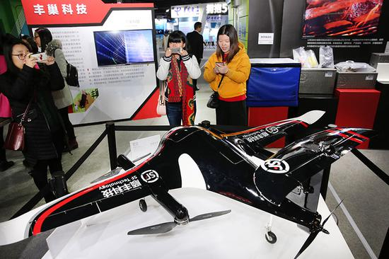Leading courier SF Express displays its drone at an information technology exhibition. (Photo by Xu Congjun/for China Daily)