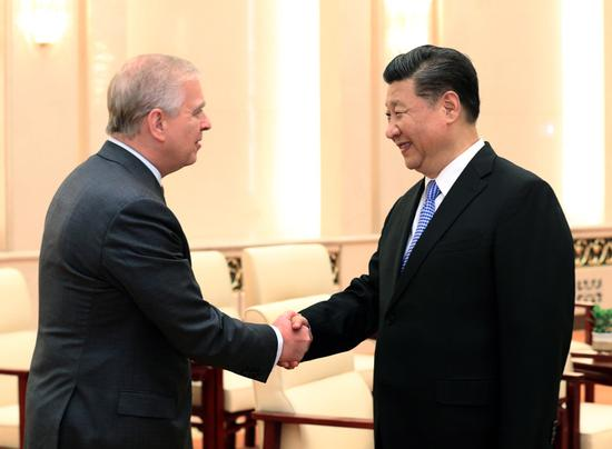 President Xi Jinping meets Britain's Prince Andrew, the Duke of York, at the Great Hall of the People in Beijing on Tuesday. Xi expressed his appreciation for the prince's efforts to further advance China-UK relations. (Photo/CHINA DAILY)