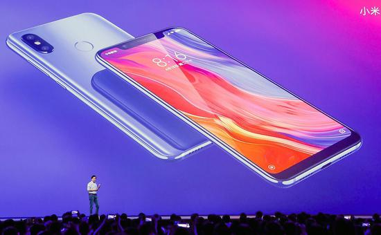 Lei Jun, CEO of Xiaomi, unveils a flagship smartphone with a transparent glass back panel on Thursday.  (Photo provided to China Daily)