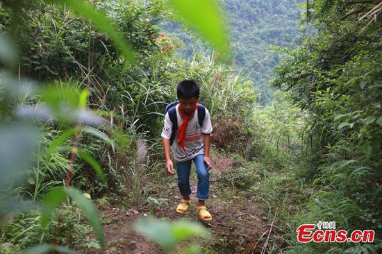 Boy walks 3 hours a day to mountain primary school