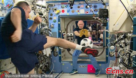 Russian cosmonauts show off football skills in space