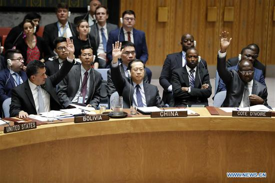 China's permanent representative to the United Nations Ma Zhaoxu (C, front) votes in favor of a Kuwaiti-drafted Security Council resolution on the protection of the Palestinians at the UN headquarters in New York, June 1, 2018. Ma Zhaoxu on Friday explained Beijing's stance on a Kuwaiti-drafted Security Council resolution on the protection of the Palestinians. (Xinhua/Li Muzi)