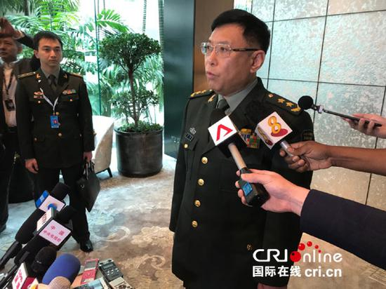 China, U.S. militaries should further enhance ties, says Chinese official