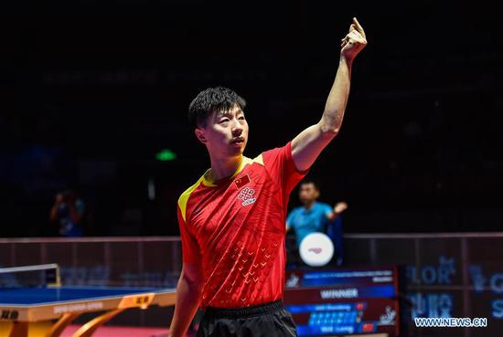 Ma Long takes men's singles title at China Open