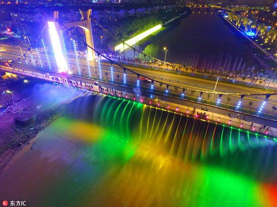 Colorful suspension bridge becomes local attraction in Nanjing
