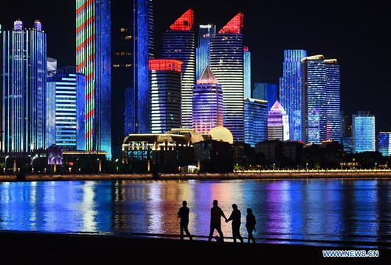 Photo taken on May 3, 2018 shows the night view of Fushan Bay in Qingdao, east China's Shandong Province. The 18th Shanghai Cooperation Organization (SCO) Summit is scheduled for June 9 to 10 in Qingdao. (Xinhua/Li Ziheng)