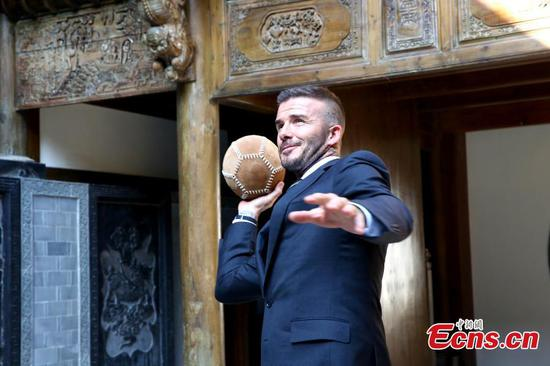 Beckham tries ancient football in China