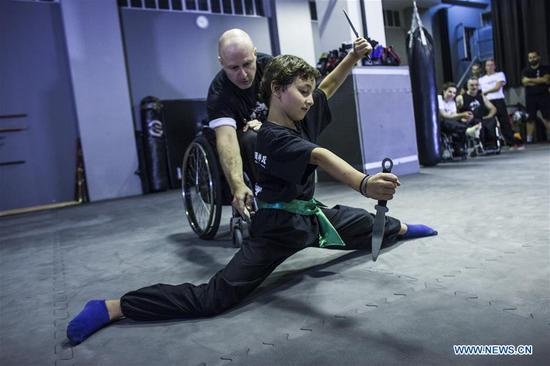 Wushu teacher in wheelchair in Greece