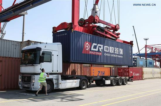 A cargo container of China Railway Express train is loaded on a truck at Eurokombi terminal in Hamburg, Germany, on May 29, 2018. (Xinhua/Shan Yuqi)