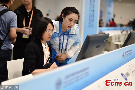 University volunteers help reporters at SCO press center